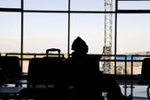 Silhoutte of a muslim passenger in airport terminal — Stock Photo