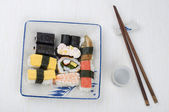 Varieties of sushi set on a plate — Stock Photo
