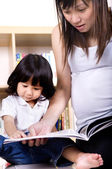 Asian mother and child learning — Stock Photo