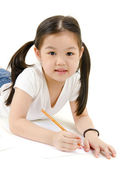 A young asian girl drawing a picture. On white — Stock Photo
