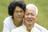 Asian Senior Couple at outdoor park — Stock Photo