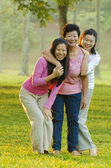 Asian mother anddaughters — Stock Photo