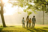 A family walking in the park — Stock Photo