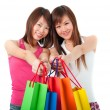 Happy Asian girls standing in shopping bags — Stock Photo