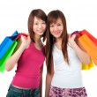 Happy asian girls shopping — Stock Photo