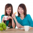 Asian girls eating — Stock Photo