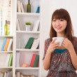 Stock Photo: Aisan girl enjoying coffee