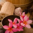 Tropical spa setup with frangipani flower - Stock Photo