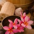 Tropical spa setup with frangipani flower — Stock Photo #14931997