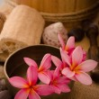 Tropical spa setup with frangipani flower — Stock Photo