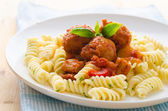 Tasty looking spaghetti bolognese, focus on meatballs — Stock Photo