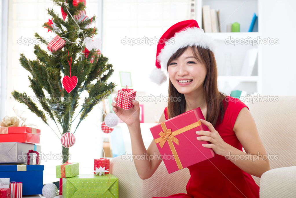 Asian girl during christmas happily with her gifts — Stock Photo #14930847