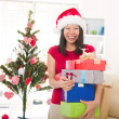 Royalty-Free Stock Photo: Asian girl during christmas with her presents