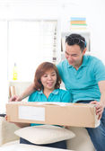 Asian couple doing online shopping — Stock Photo