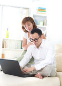 Asian couple doing online shopping — Stock Photo