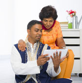 Indian family lifestyle photo surfing on the Internet, son and m — Stock Photo