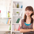 Chinese female in living room - Stock Photo