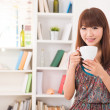 Aisan girl enjoying coffee at her living room — Stock Photo