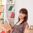 Chinese female online shopping — Stock Photo