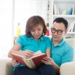 Asicouple reading — Stock Photo #16893673