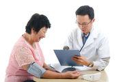 Asian senior female medical checkup — Stock Photo