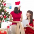 Asian girls christmas online shopping — Stock Photo #17588339