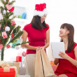 Asian girls christmas online shopping — Stock Photo