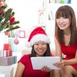 Asian girls christmas online shopping — Stock Photo #17588401