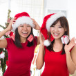 Chinese girls celebrating christmas — Stok fotoğraf