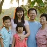 Asian family outdoor enjoyment — Stock Photo #17588567
