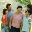 Asian family outdoor quality time - Stock Photo