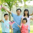 Asian family during independence day — Stock Photo