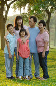 Asian family outdoor enjoyment — Stock Photo