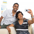 Indian family lifestyle photo , son and mother taking self photo — Stock Photo #17871151