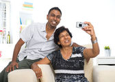 Indian family lifestyle photo , son and mother taking self photo — Stock Photo