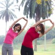 Asian girls streching outdoor — Stock Photo #18069121