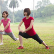 Asian girls streching outdoor — Stock Photo