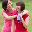 Stock Photo: Asian girl friends having fun after a workout outdoor