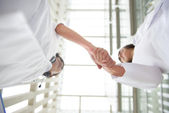 Two young medical doctors shaking hands — Stock Photo