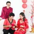 Chinese new year family with ang pow — Stock Photo #18297067