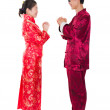 Asian couple celebrating chinese new year in traditional clothes — Stock Photo #18296293