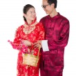 Stock Photo: Chinese new year couple with basket visiting relatives during fe