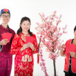 Happy chinese new year greetings by family — Stock Photo