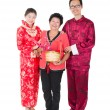 Chinese new year family with ang pow symbol of luck — Stock Photo