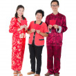 Stock Photo: Chinese new year family with ang pow symbol of luck