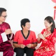 Chinese new year family with good luck wishes — Stock Photo #18297031