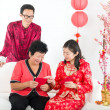 Chinese new year family with ang pow — Stock Photo