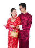Chinese new year couple with basket visiting relatives during fe — Stock Photo