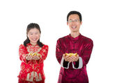 Chinese new year couple with gold coins during festival — Stock Photo