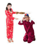 Asian bride punishing his groom — Stock Photo